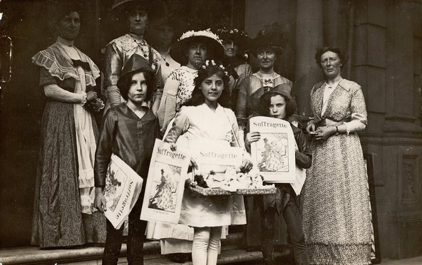 Group of children holding copies of