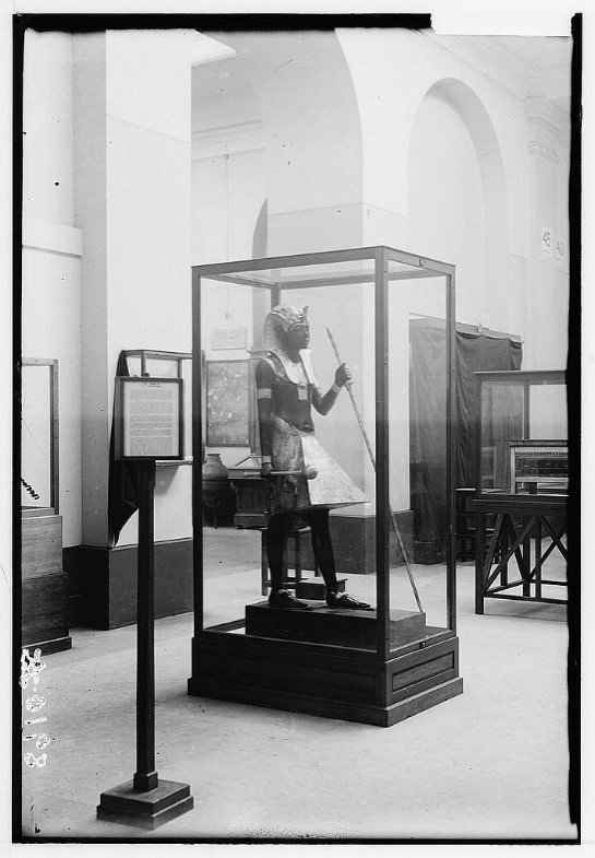 One of the guardian statues from the tomb of Tutankhamun on display in the Egyptian Musuem, Cairo, in the 1930s. Library of Congress.