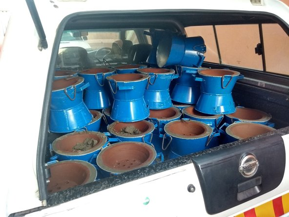 Finished cookstoves piled up in a car boot