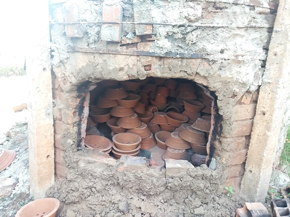 New parts for cookstoves piled up in a kiln