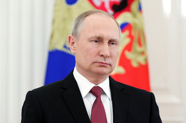 Russian President Vladimir Putin delivers a televised address to the nation in Moscow on March 23, 2018