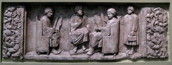 A relief of a Roman teacher with three discipuli. Image credit: Wikipedia / Shakko.