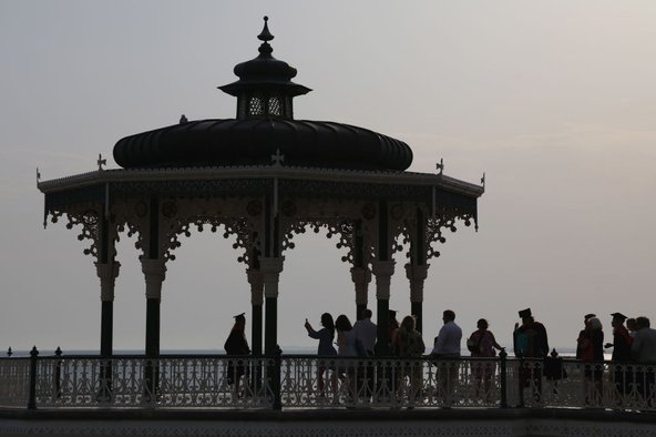 Sussex University students celebrate their graduation at the Bandstand on Brighton Beach, July 2019. Photo by Stephen Bardens / Getty Images