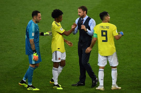 England's coach, Gareth Southgate, shakes hands with Juan Cuadrado of the Colombian team at the end of the Colombia v England match. Image credit: Francisco Leong / AFP / Getty Images.