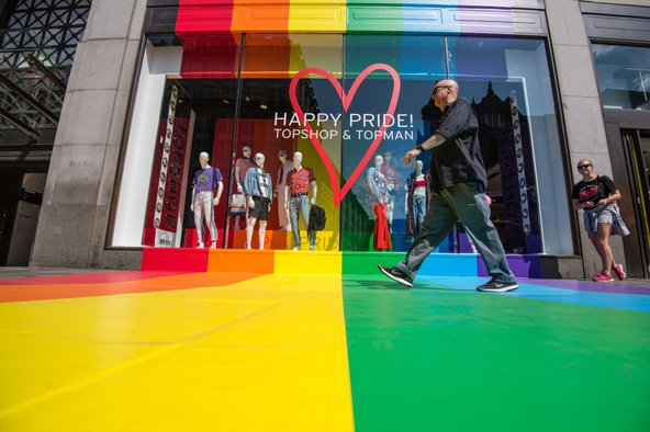 The Pride Festival takes place in London annually, with many shops decorating their stores with Pride flag colours. Image credit: Carl Court / Getty Images.