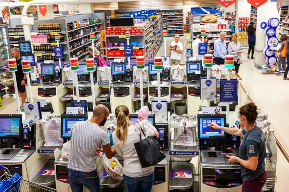 Shoppers at a supermarket checkout