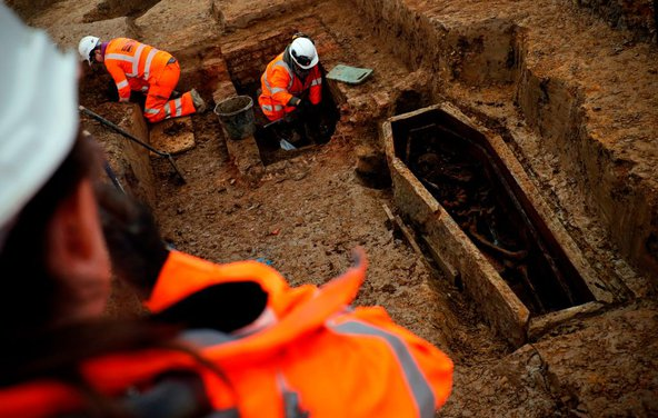 Field archaeologists work on the excavation of a late 18th to mid-19th century cemetery under St James Gardens near Euston train station in London as part of the HS2 high-speed rail project. Photo by Adrian Dennis/AFP/Getty Images.