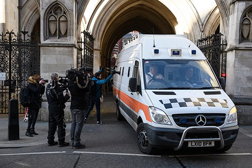 Members of the media look on as a prison van carries convicted rapist John Worboys from the High Court on February 7, 2018 in London, England. A judicial review hearing on March 13 allowed victims to challenge his planned release.